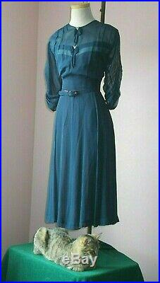 Delightful navy dress. Love the see through slip.'diamond bows c. 1945